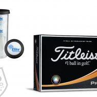 Logo'd titleist golfball and gold tees