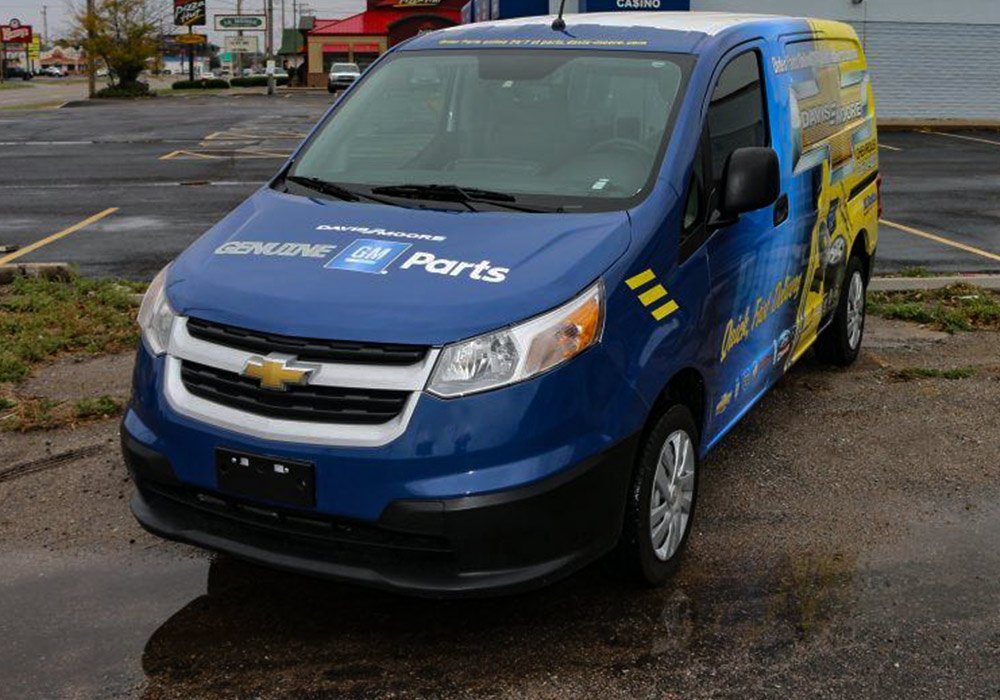 Traffic jams become an advertising opportunity for this Davis Moore GM Parts Delivery Fleet Van Wrap.